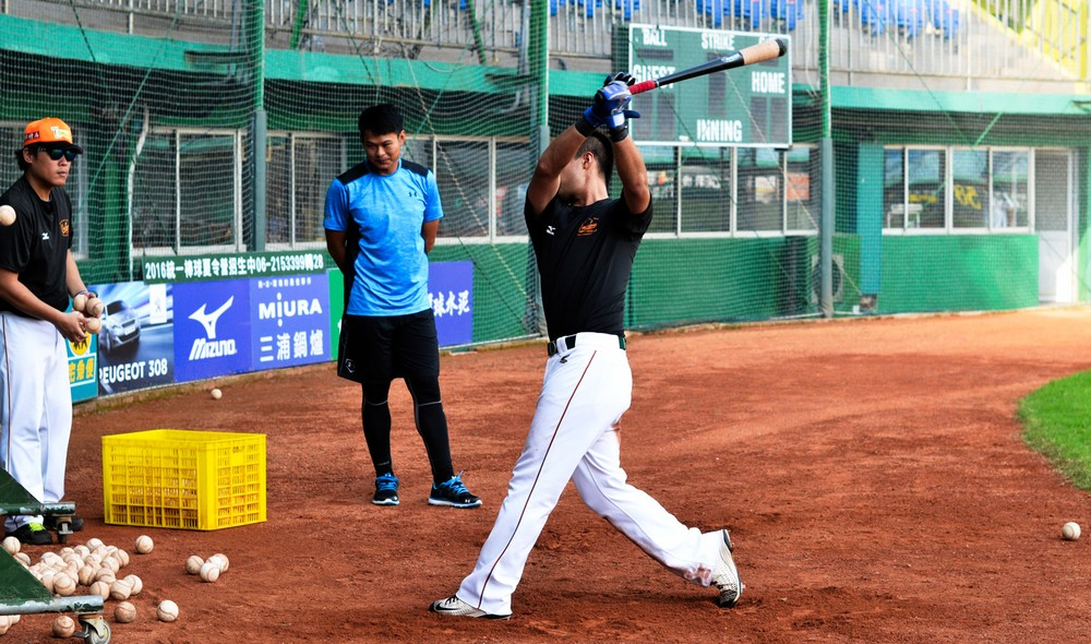 a-player-gets-in-practice-swings-before-the-game