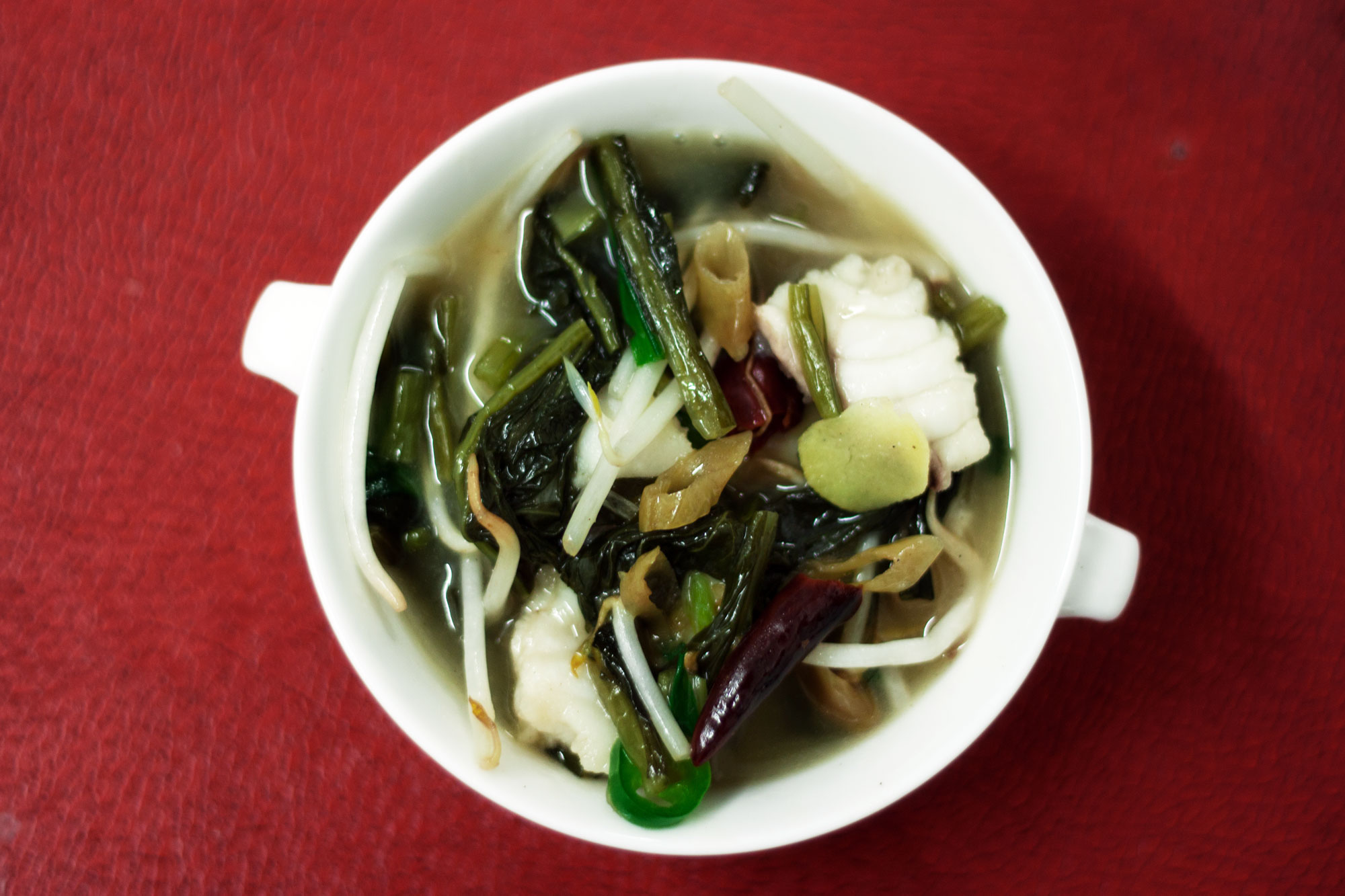 CNYspicy-fish-broth-with-pickled-vegetables