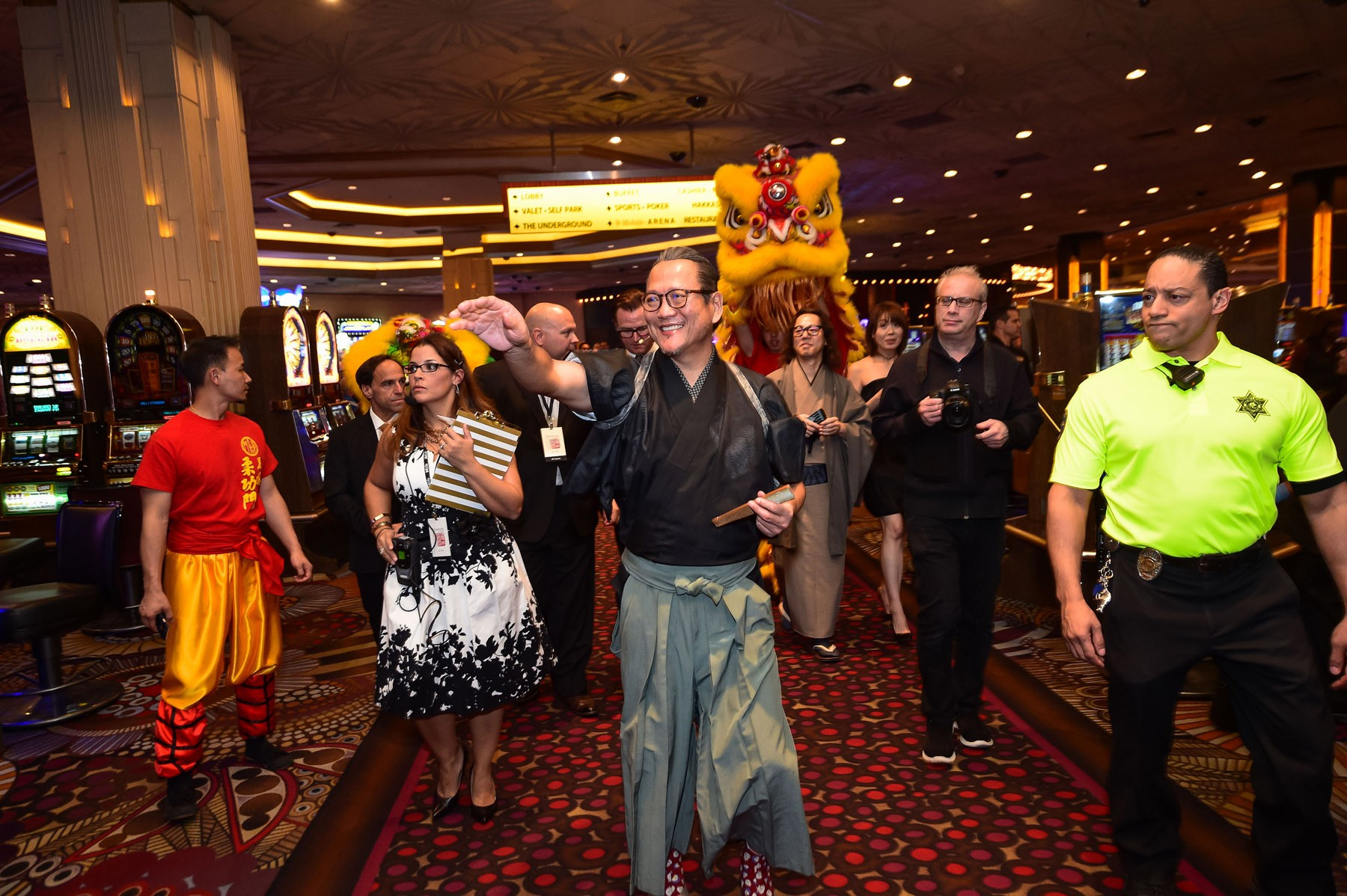 chef-masaharu-morimoto-leading-parade-of-lion-dancers-through-mgm-grand
