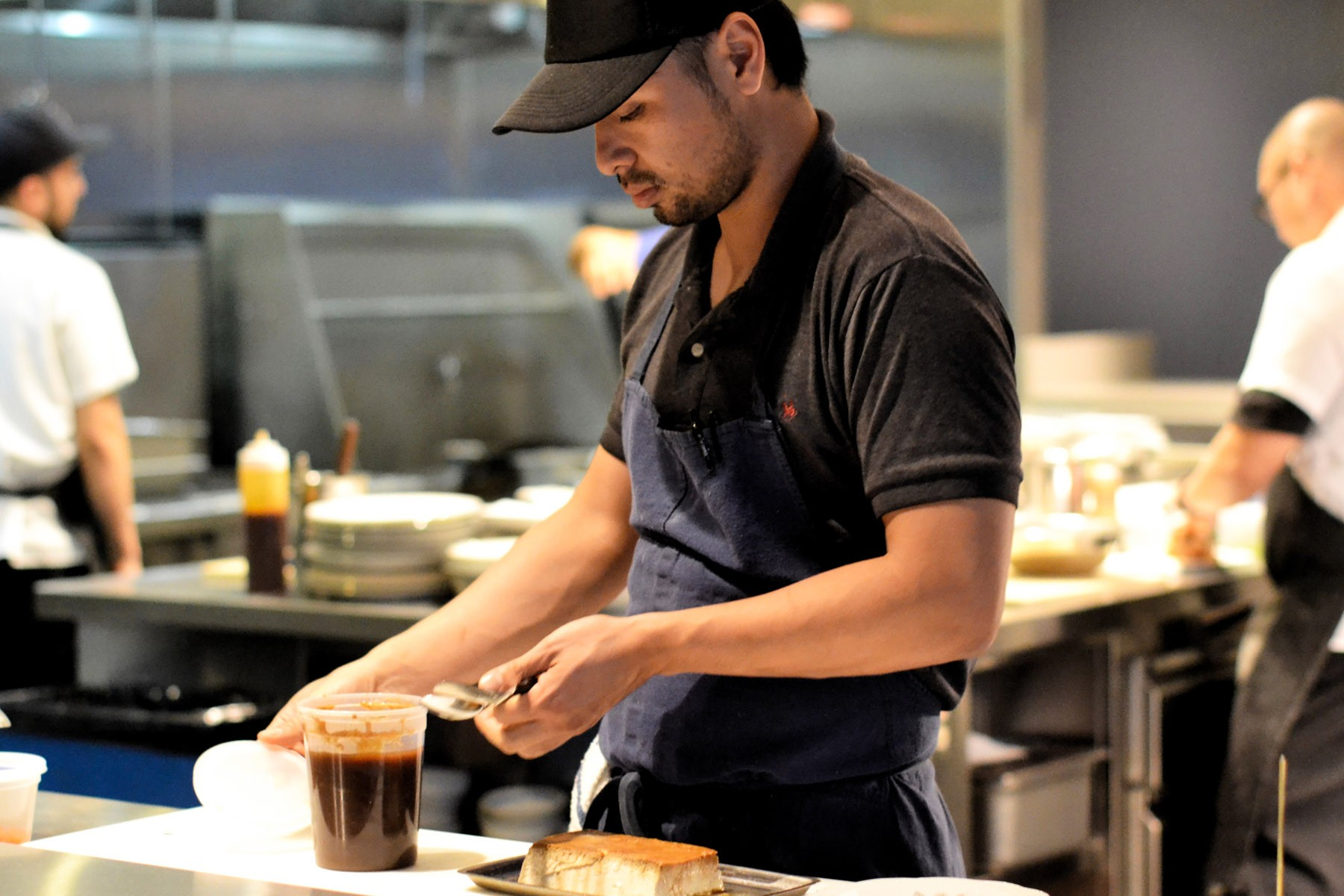 Chef Shawn Pham plates the Coconut Flan with tamarind caramel, and coconut snow.
