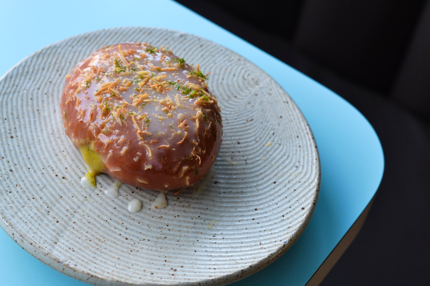 dotolo-and-taymors-coconut-curry-donut-with-a-clear-lime-glaze-makrut-lime-zest-and-toasted-coconut