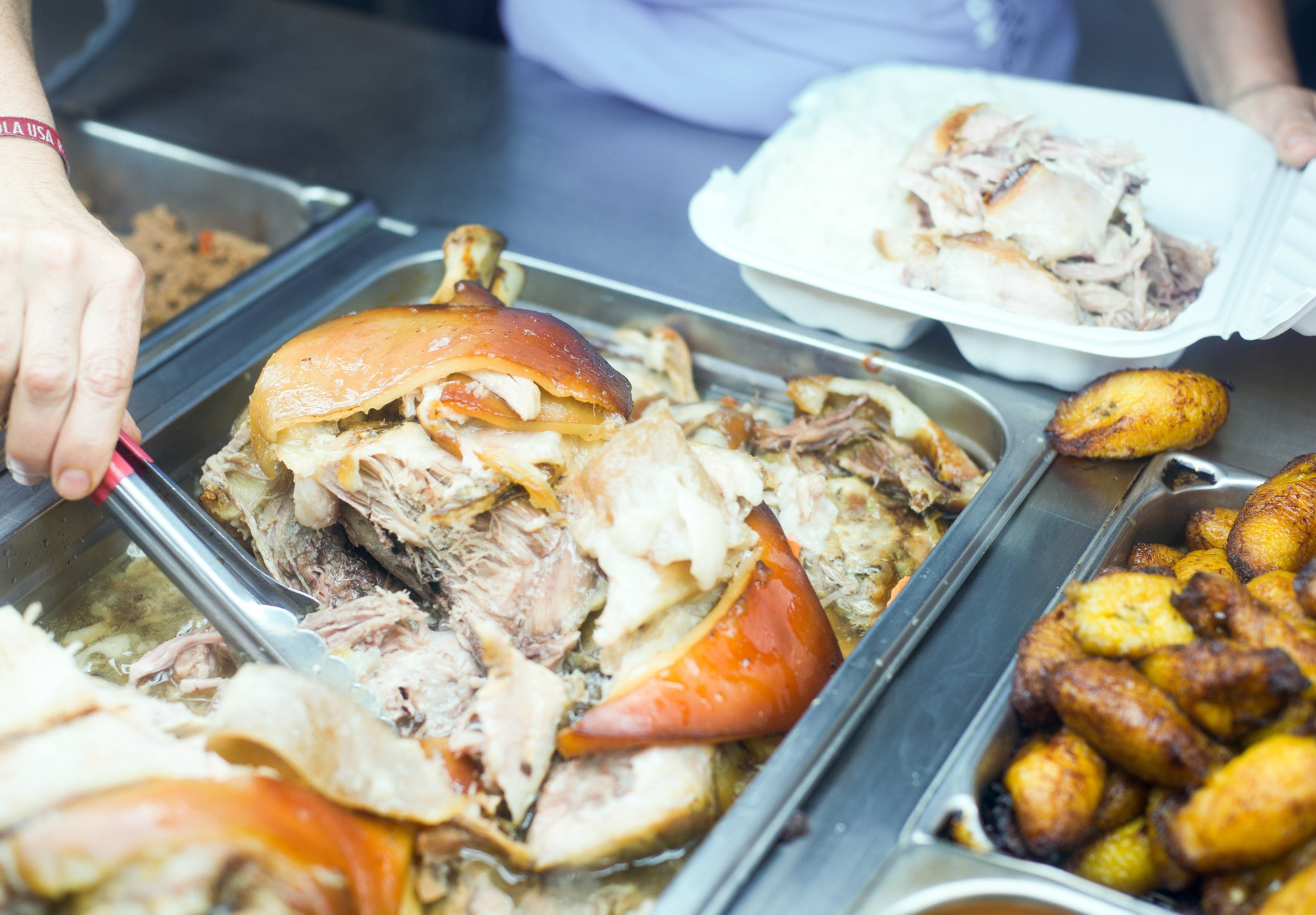 Las Olas Cafe serving lechon
