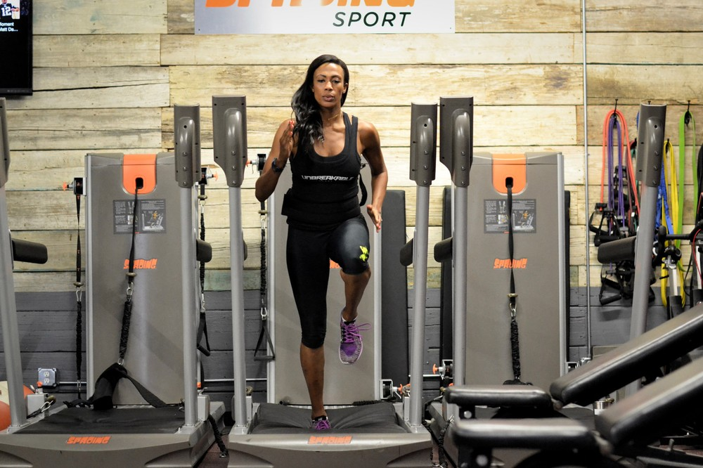 Olympic medalist Kim Glass demonstrates how to use the Sproing machine