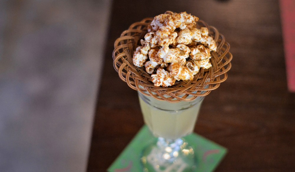 The GMtini hints at Thailand's GMO issues, serving laap-seasoned popcorn on top.