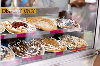 The Funnel Cake booth at the Minnesota State Fair serves a variety of funnel cakes ranging from Nutella Oreo to chocolate caramel sundae.