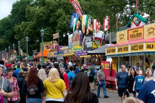 Visitors crowd the food booth lined streets of the Minnesota State Fair.