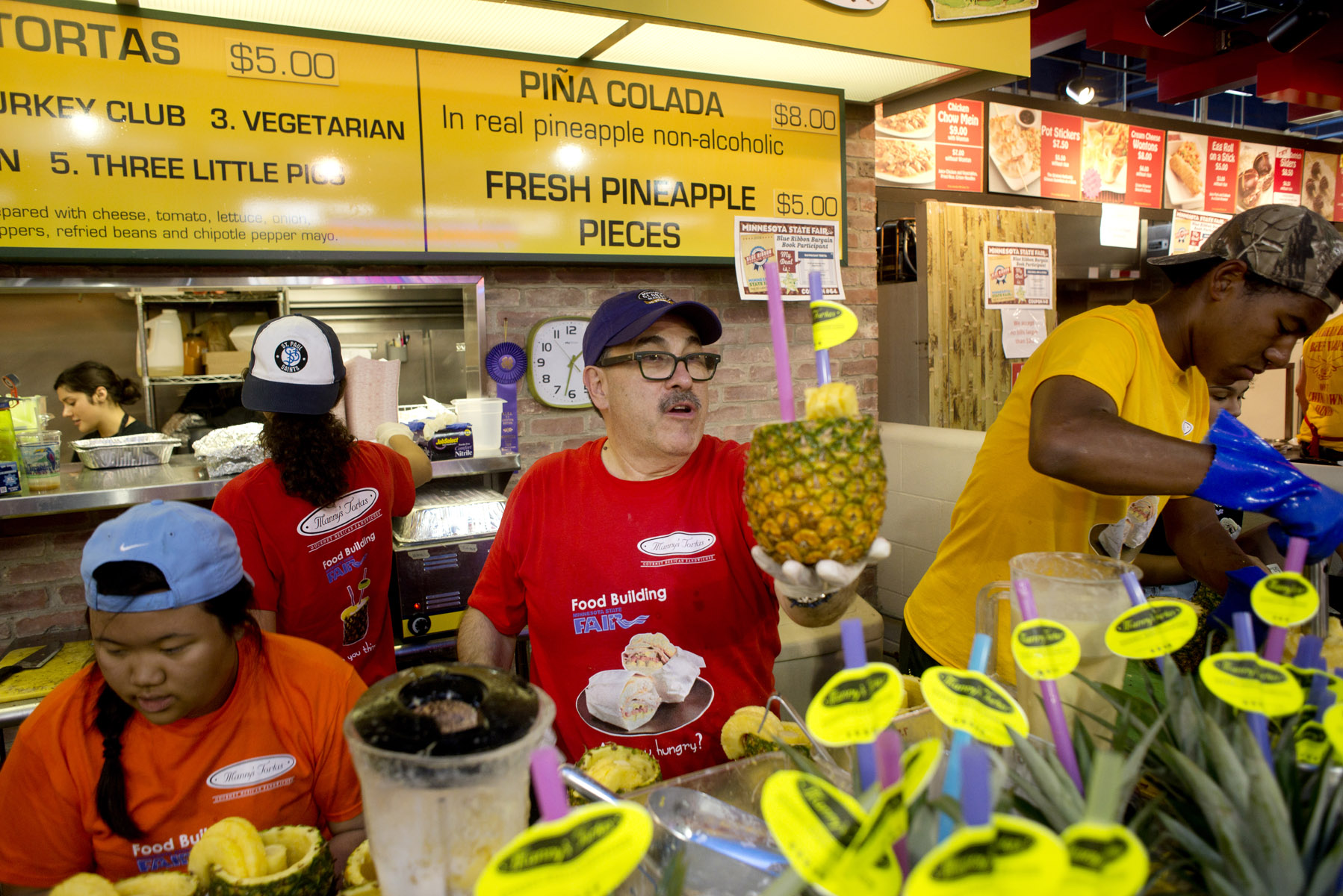 Manny Gonzalez, owner of Manny's Tortas, blends ingredients for his non-alcoholic pina colada during the Minnesota State Fair.