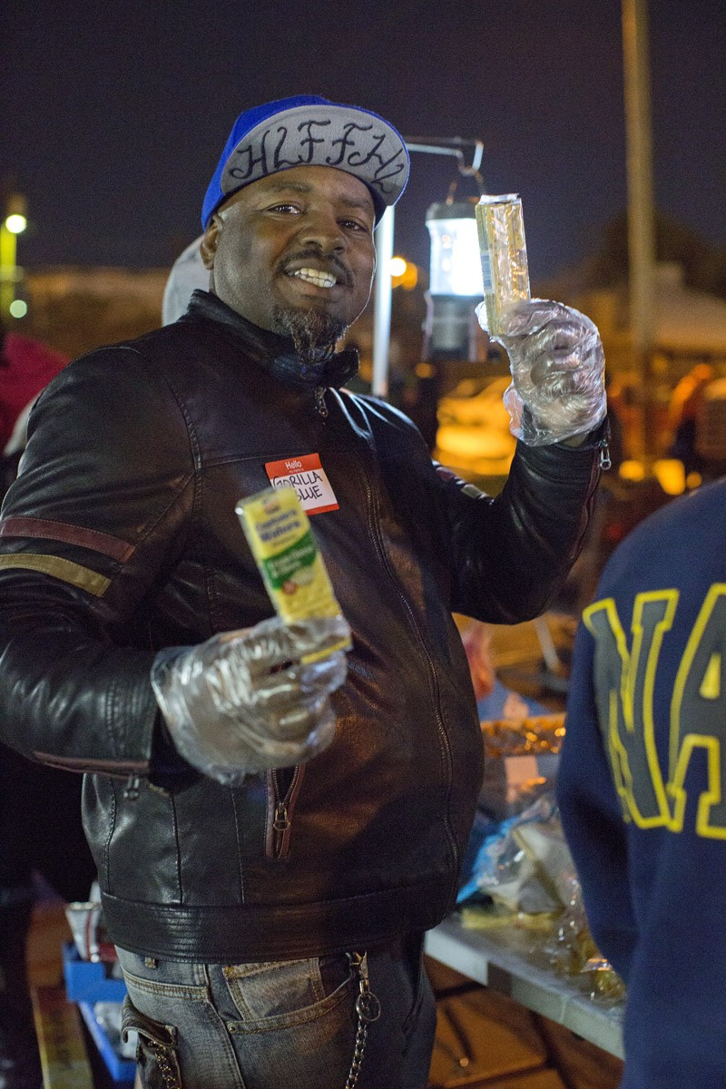 Volunteer holds packaged snacks