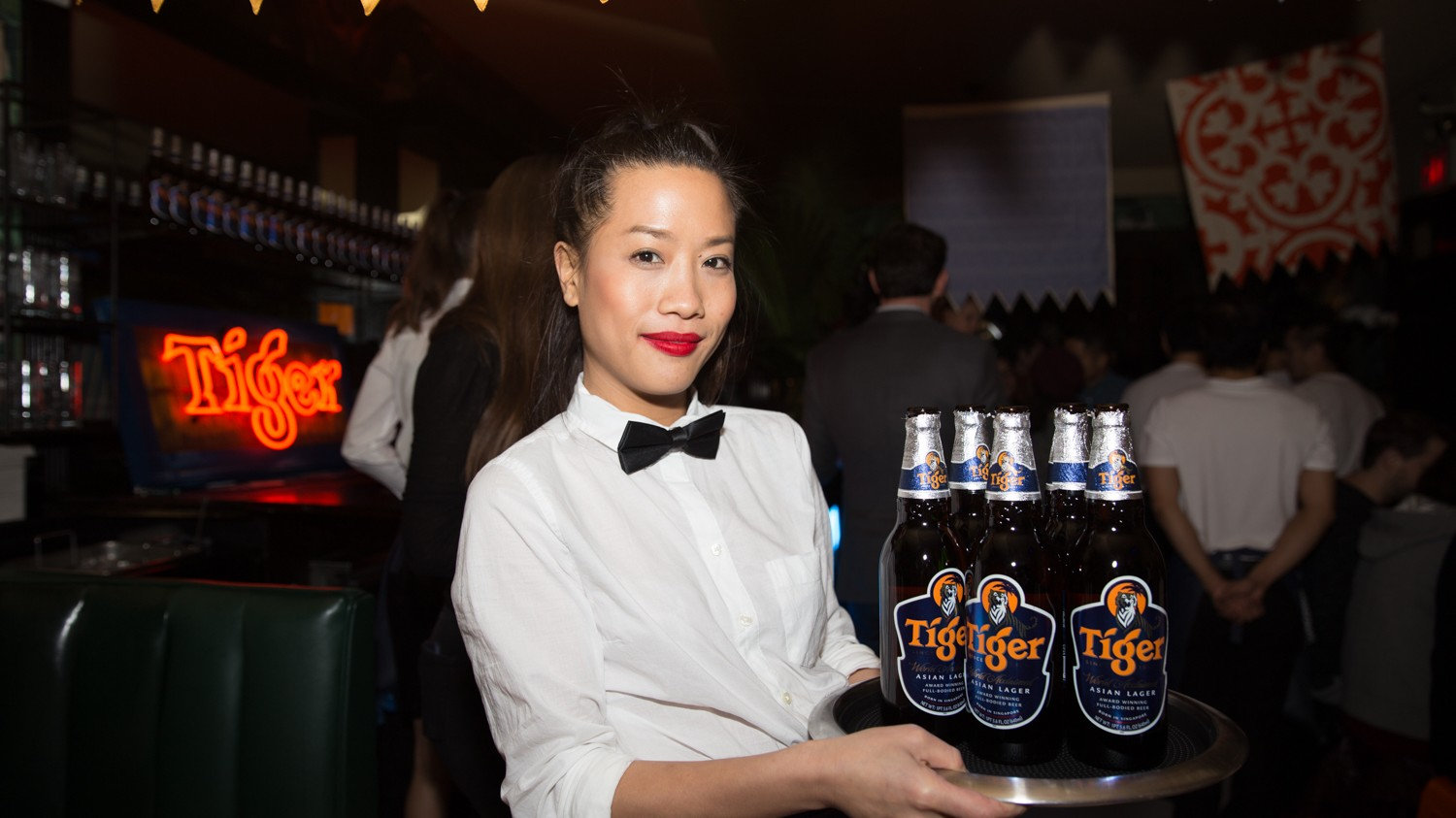 waitress-bringing-tiger-beer-to-guests-please-credit-laura-june-kirsch