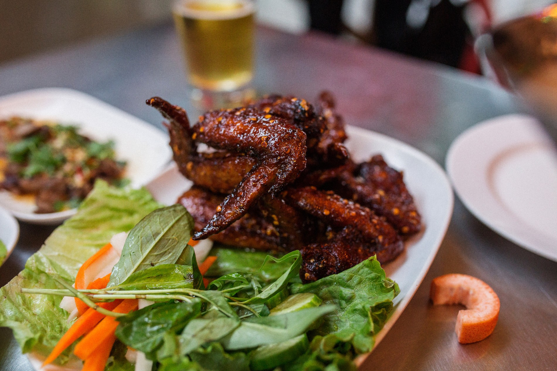Ikeís Vietnamese Fish Sauce Wings Half dozen fresh whole natural chicken wings marinated in fish sauce and sugar, deep fried, tossed in caramelized Phu Quoc fish sauce and garlic and served with Vietnamese table salad Pok Pok PDX Mushrooms in Portland, Oregon. August 2016. Matt Lutton / Boreal Collective for Vice Munchies