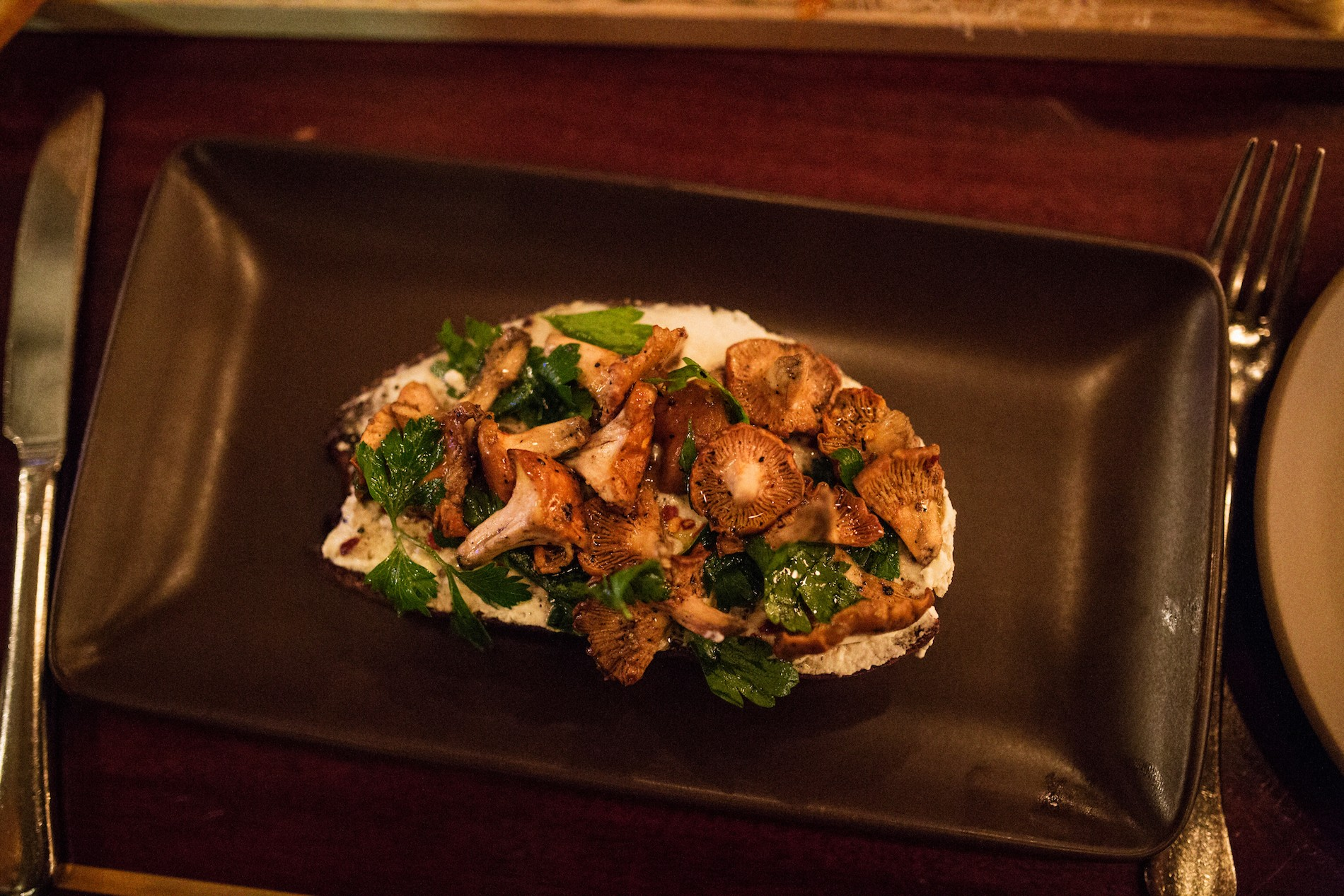 Dinner at Ava Gene's in Portland. A toast made with our foraged chanterelles. Mushrooms in Portland, Oregon. August 2016. Matt Lutton / Boreal Collective for Vice Munchies
