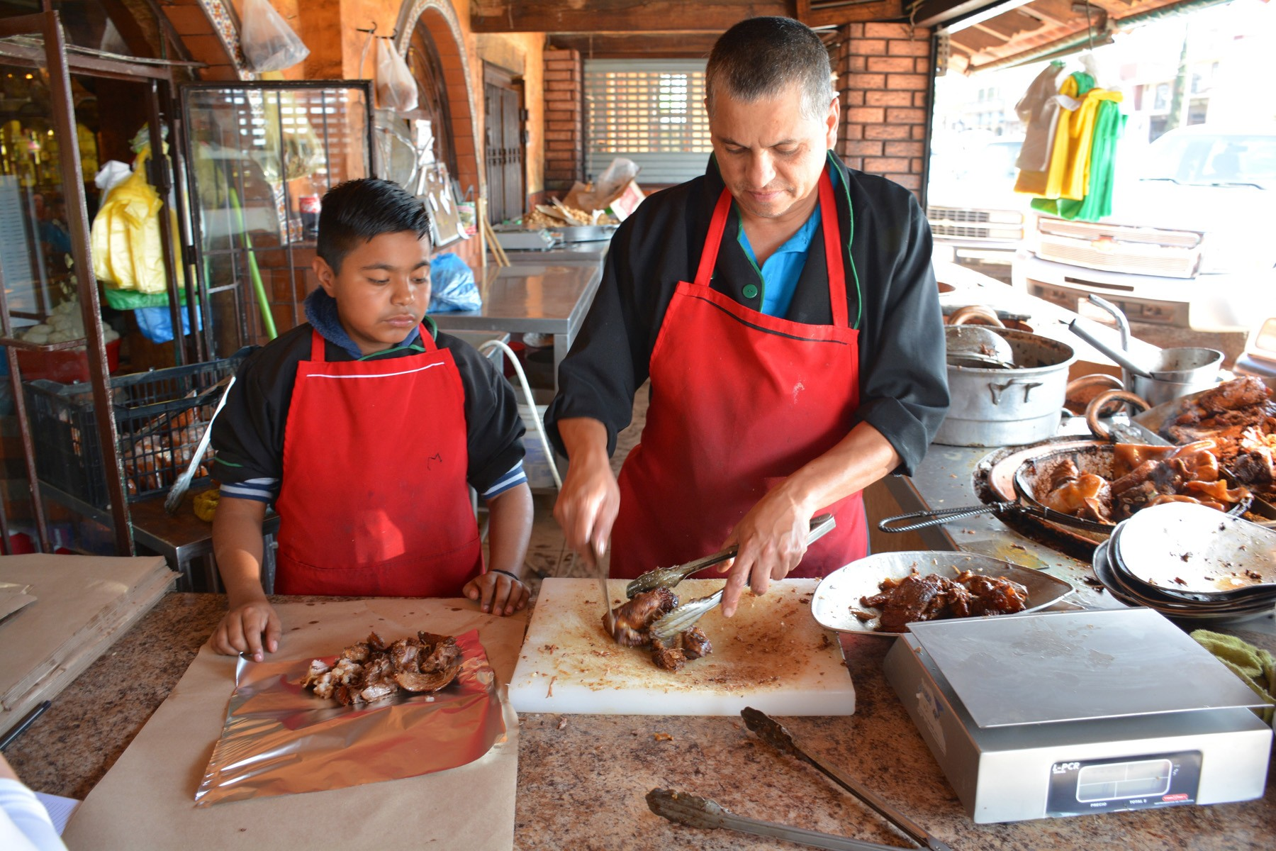 carnitas_chopping_with_son - 1