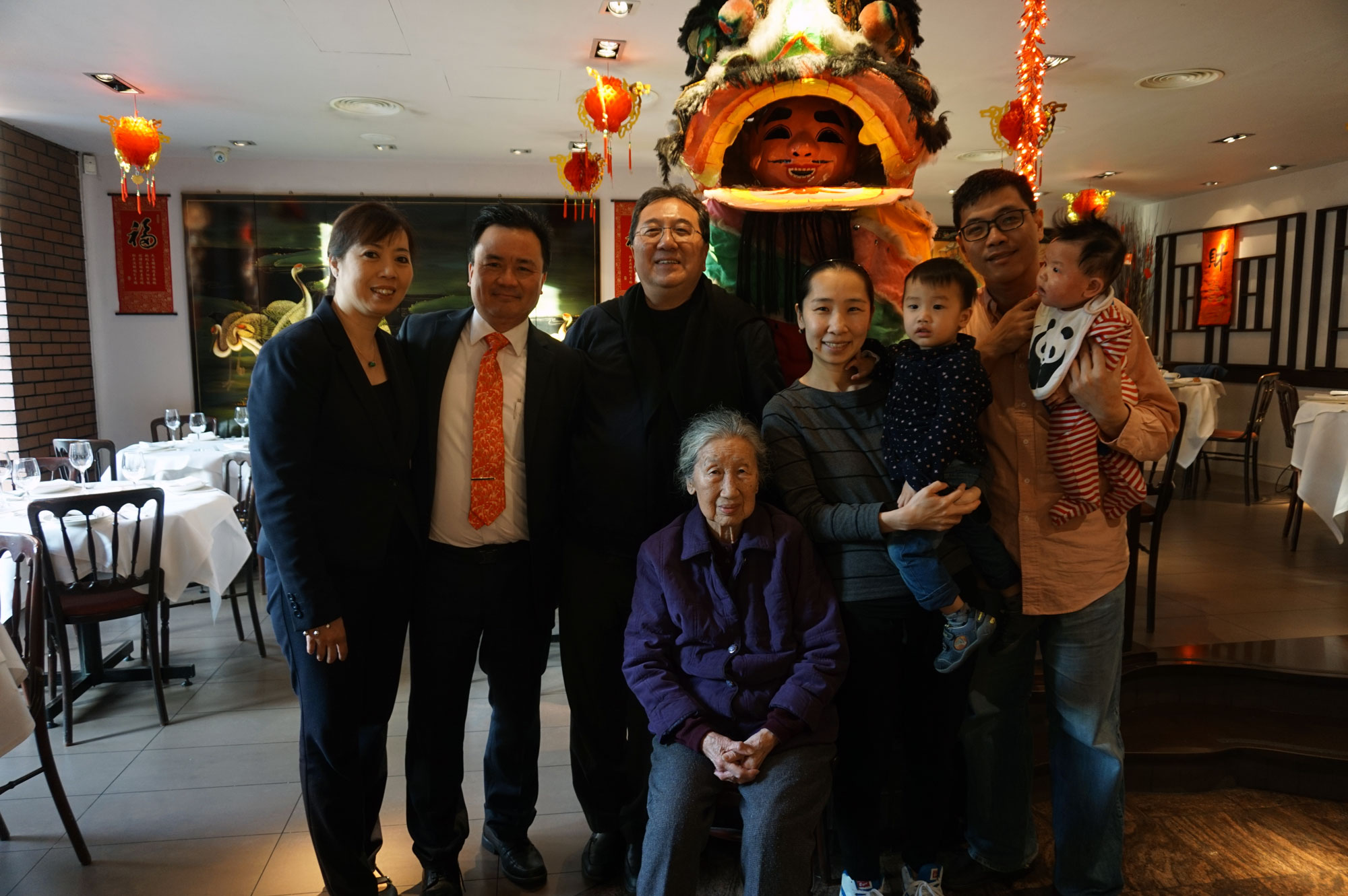 maxim-Chow-Family_-L-R-Tony-Front-of-House,-Son-Tony-Chow,-Granddaughter-Jocelyn,-Her-Kids-and-Her-Husband,-Mrs.-Chow-sat-down.JPG