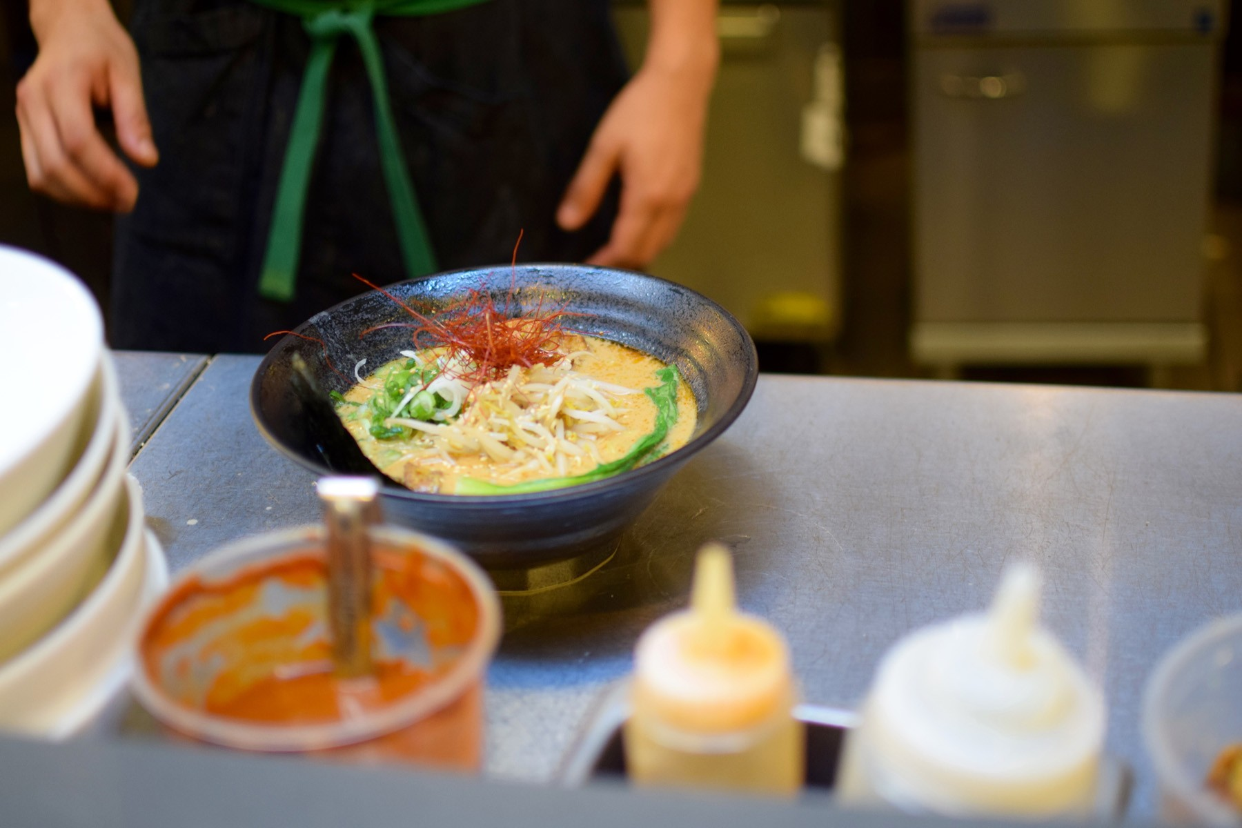 on_the_line_at_ramen_hood_with_sauces - 1