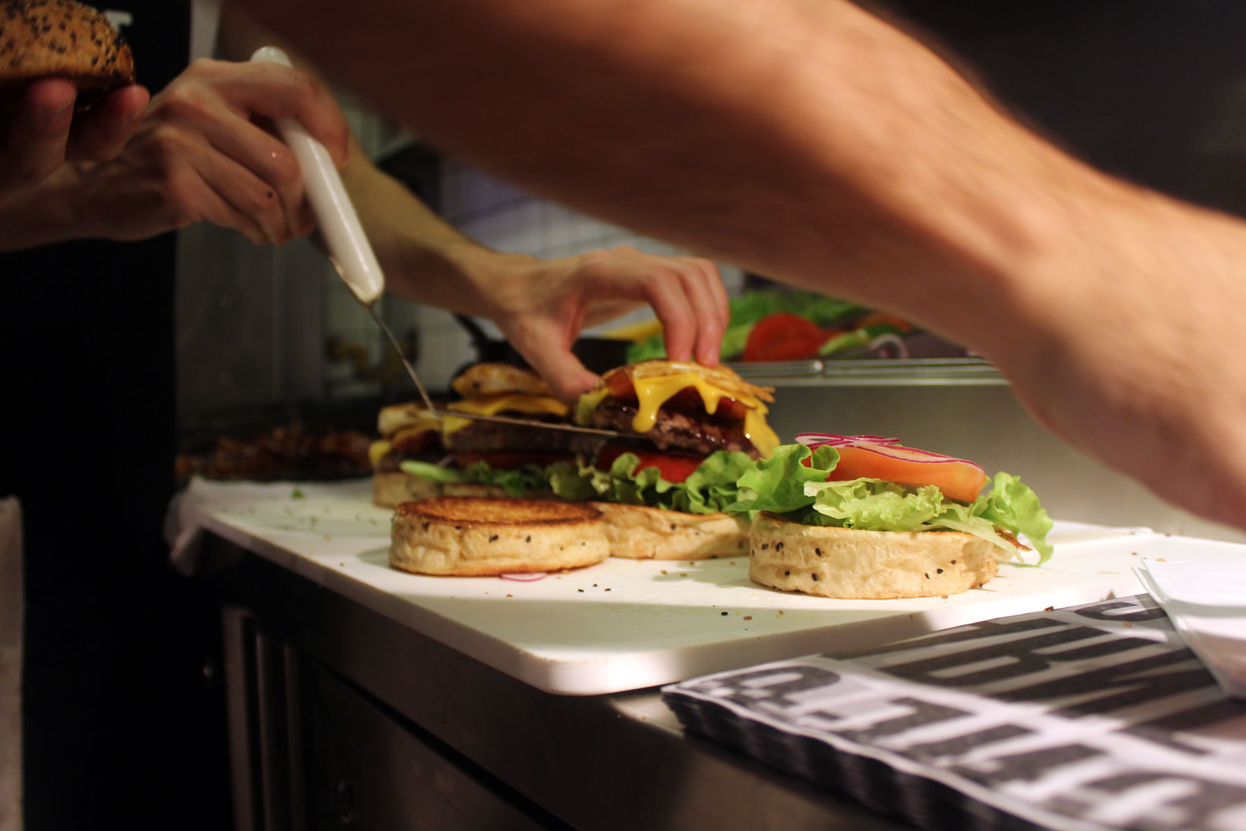 putting-dressing-on-burgers