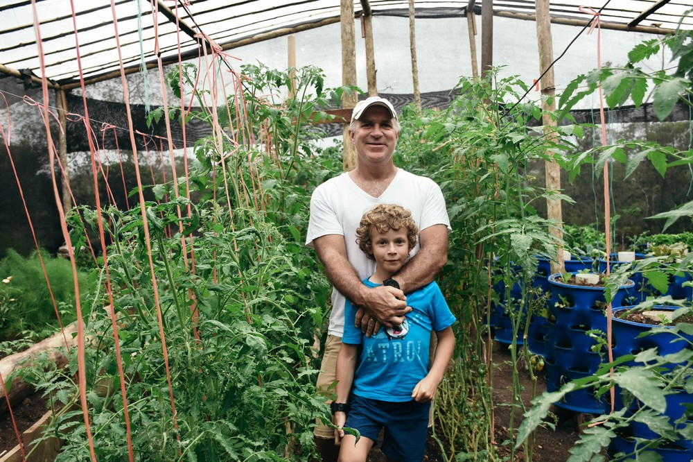 scott-with-son-ian-in-vegetable-farm_31024432203_o