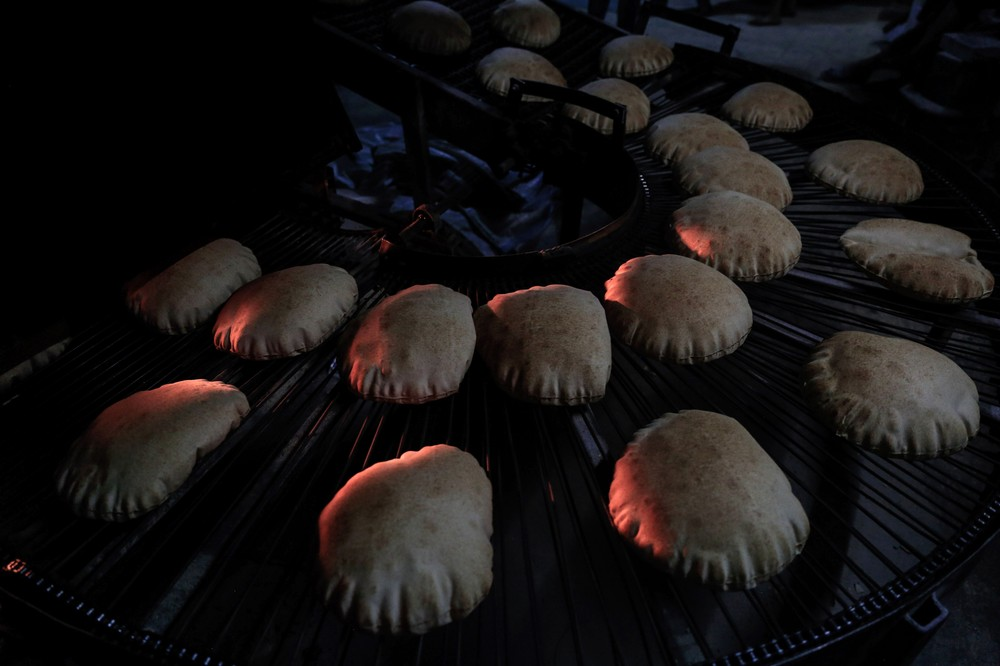A picture taken on June 19, 2016 shows pita bread at a bakery in the rebel-held town of Douma, east of the Syrian capital Damascus, as a part of an initiative to distribute bread to impoverished families in the Eastern Ghouta area during the holy fasting month of Ramadan. The bakery is managed by the Douma Society which was created in 1960. / AFP / Sameer Al-Doumy (Photo credit should read SAMEER AL-DOUMY/AFP/Getty Images)