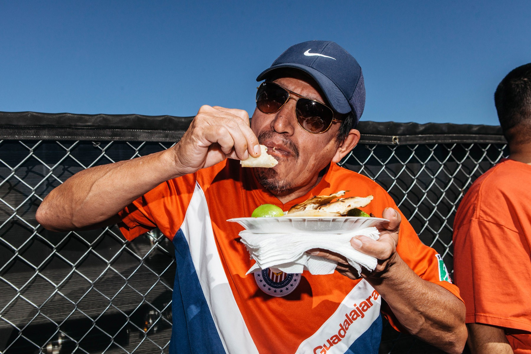 Culinary Union Member Javier Zamudio Cruz eats a taco.